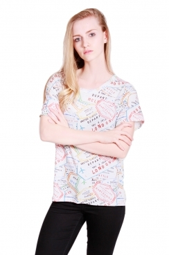 Charlie oversized t-shirt with passport stamps.