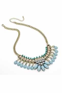 Gold chain detailed with turquoise, pearl and blue beads detailed with crystal centre.
