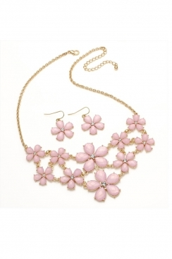 Gold coloured necklace and earrings with baby pink coloured  floral shaped beads. necklace and earring set.
