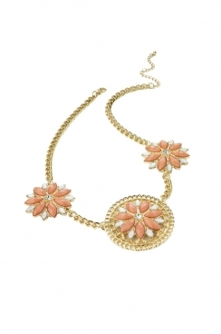 Gold necklace with coral and white 3 floral flowers with crystal centres.